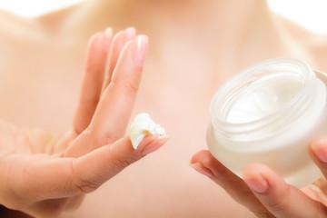 Skin care. Moisturizing cream in female hands