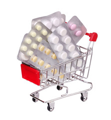 pills in shopping cart isolated on white background