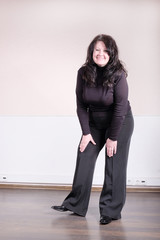 Middle aged woman with black blouse. Full length posing
