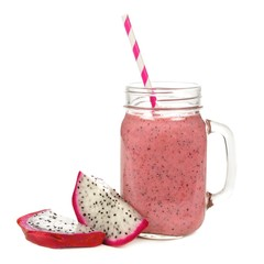 Pink smoothie in jar glass with dragon fruit isolated on white