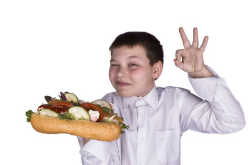 delicious hot dogs holding a boy