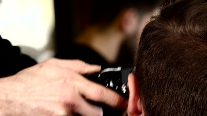 Barbershop: the wizard cut machine close up. Men's haircut in a