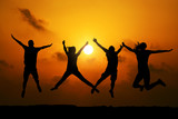 Fototapety Four friends jumping  at sunset