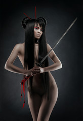 Oriental nude woman with sword
