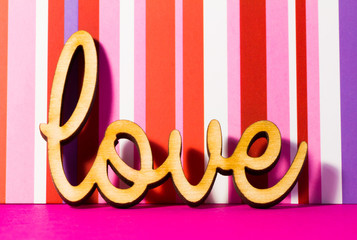 Wooden Love inscription on red striped background
