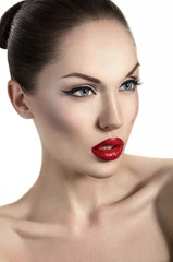 Portrait of sexy woman with red lips and perfect skin