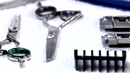 Barbershop: hairdresser's tools lying on a white towel. close up