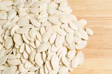 dried pumpkin seeds, on wooden background