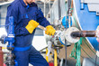 Mechanic repairing machine in industrial plant - 80353583