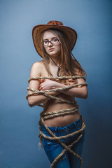 Woman glasses, wrapped a rope in cowboy hat