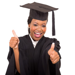 african college graduate giving thumbs up