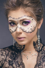 Woman with creative make-up.Face-art