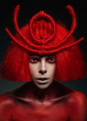 Creative portrait of woman with red wig