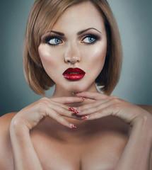 Pretty young woman wth manicure