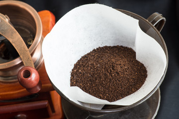 Freshly ground coffee with a mill or grinder