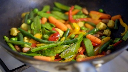 Preparing vegetables mix in the pan