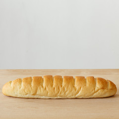 bread on wooden table with white background