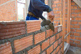 Worker building masonry house wal