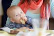Baby boy having piece of bread - 80356979