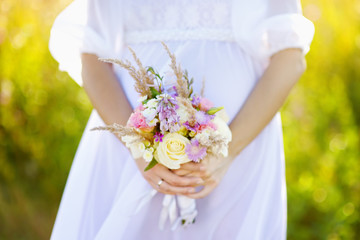 Woman holding wedding bouquet