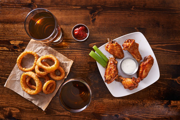 appetizer sampler with onion rings and chicken wings