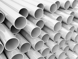 Stack of plastic pipes close up image