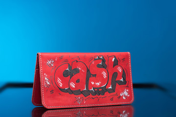 red woman clutch bag. with the words cash
