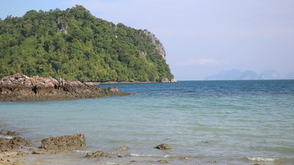 view of cliff tropic islands in azure sea in Thailand