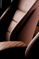Leather car seat close up photo