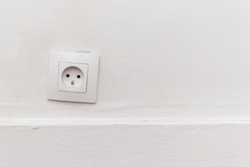 outlet on the white wall