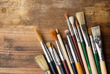 Paintbrushes on a wood background, - 80361522