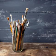 Paintbrushes on a wood background,