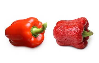 Wrinkled and fresh pepper isolated
