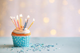 Delicious birthday cupcake on table on light background - 80362106