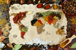 Leinwanddruck Bild - Map of world made from different kinds of spices