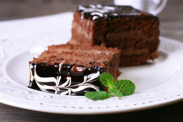 Tasty pieces of chocolate cake with mint