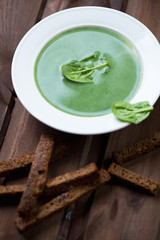 Close-up of freshly made spinach soup, studio shot