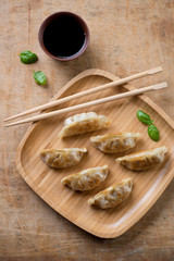 Japanese traditional pan fried gyoza with soy sauce, above view
