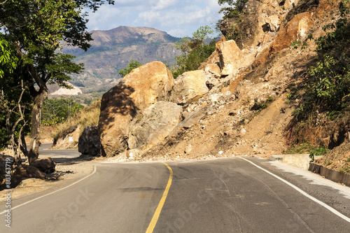Leinwanddruck Bild Landslide in the middle of a roadway in El Salvador