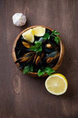 Steamed mussels with parsley, lemon and garlic, above view