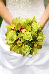 Bride Holding Bouquet Of Green Roses And Orchids