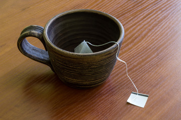 Сlay cup with teabag.