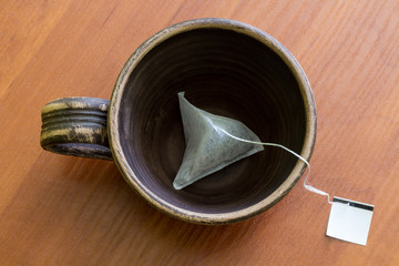 Сlay cup with teabag.  Top view.