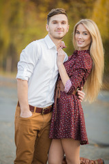 Young couple in love outdoors in autumn in the park.
