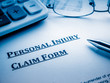 personal injury claim form on desk. - 80364705