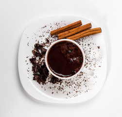 isolated white cup of hot chocolate with cinnamon. Top view