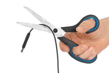 Hand with scissors and computer cable