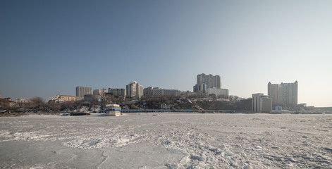 Vladivostok cityscape, day. Winter. View from the Sea of Japan.