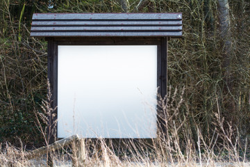 blank information board in the nature with  space for your text