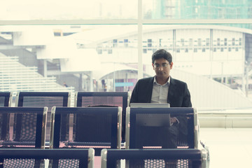 indian business male waiting at the airport
